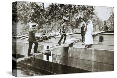 Patients being taken on board a hospital barge, Somme campaign, France, World War I, 1916-Unknown-Stretched Canvas Print