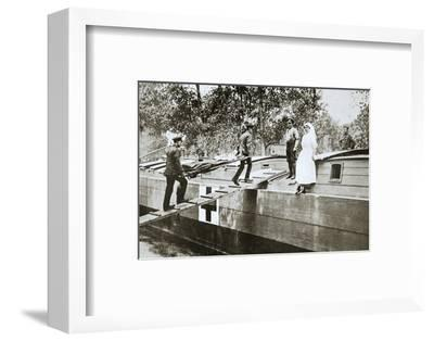 Patients being taken on board a hospital barge, Somme campaign, France, World War I, 1916-Unknown-Framed Photographic Print