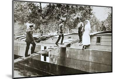 Patients being taken on board a hospital barge, Somme campaign, France, World War I, 1916-Unknown-Mounted Photographic Print