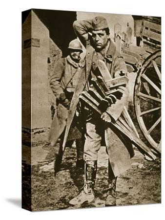 French soldier with wooden crosses to be placed on temporary graves, World War I, c1914-c1918-Unknown-Stretched Canvas Print