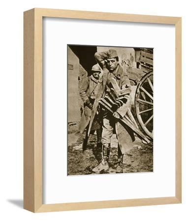 French soldier with wooden crosses to be placed on temporary graves, World War I, c1914-c1918-Unknown-Framed Photographic Print