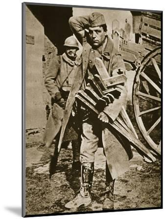 French soldier with wooden crosses to be placed on temporary graves, World War I, c1914-c1918-Unknown-Mounted Photographic Print