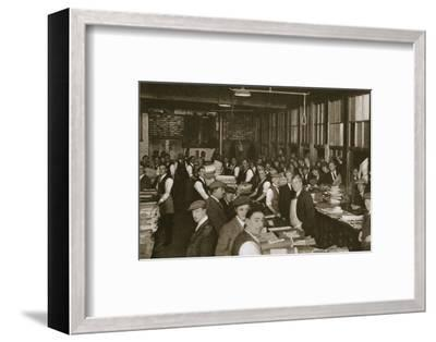 Newsvendors gather to pick up the next day's newspapers to sell, Carmelite House, 20th century-Unknown-Framed Photographic Print