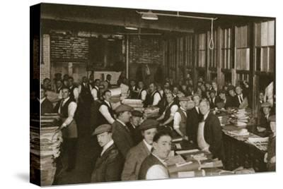 Newsvendors gather to pick up the next day's newspapers to sell, Carmelite House, 20th century-Unknown-Stretched Canvas Print
