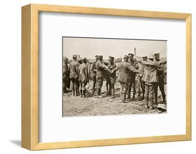 British soldiers searching captured German prisoners, Somme campaign, France, World War I, 1916-Unknown-Framed Photographic Print