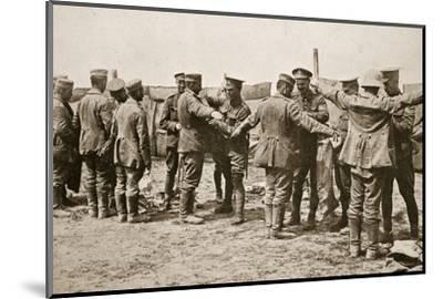 British soldiers searching captured German prisoners, Somme campaign, France, World War I, 1916-Unknown-Mounted Photographic Print