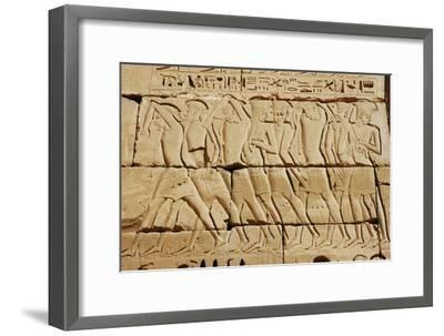 Detail of a relief on the mortuary temple of Ramesses III-Werner Forman-Framed Giclee Print