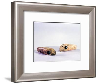 Two small ivory carvings of bird heads-Werner Forman-Framed Giclee Print