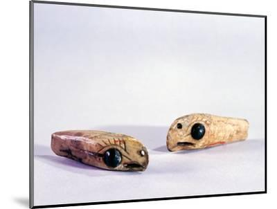 Two small ivory carvings of bird heads-Werner Forman-Mounted Giclee Print
