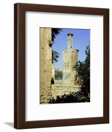 The minaret of one of the two mosques which lie inside the Chellah Necropolis-Werner Forman-Framed Giclee Print