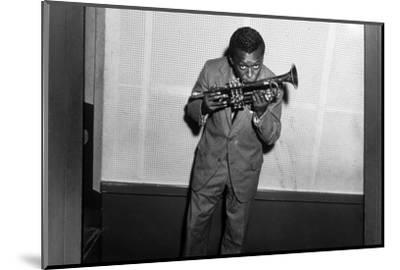Miles Davis Kissing Trumpet--Mounted Photo