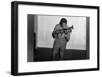 Miles Davis Kissing Trumpet--Framed Photo