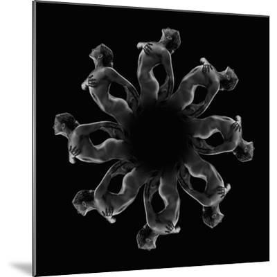 Kaleidoscope pattern of naked woman posing against black background-Panoramic Images-Mounted Photographic Print