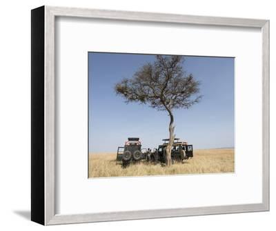 Africa, Kenya, Maasai Mara National Reserve. Tourists having lunch on Maasai Mara.-Jaynes Gallery-Framed Photographic Print