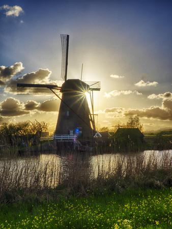 Netherlands, Kinderdijk. Windmill along the canal at sunset-Terry Eggers-Framed Photographic Print