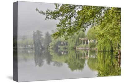 France, Cajarc. Early morning fog on the Lot River.-Hollice Looney-Stretched Canvas Print
