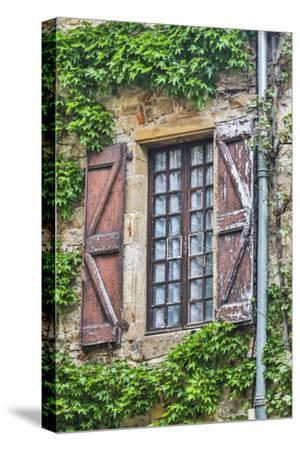 France, Cordes-sur-Ciel. Weathered shutters and window.-Hollice Looney-Stretched Canvas Print