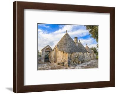 Italy, Region of Apulia, Province of Bari, Itria Valley, Alberobello. A trullo house-Emily Wilson-Framed Photographic Print