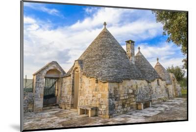 Italy, Region of Apulia, Province of Bari, Itria Valley, Alberobello. A trullo house-Emily Wilson-Mounted Photographic Print