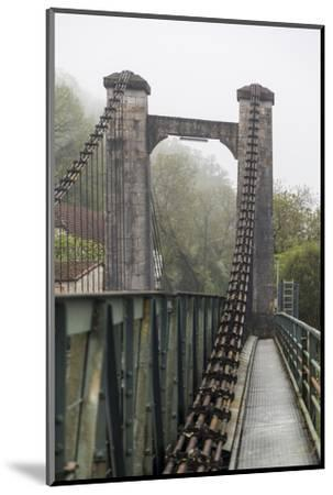 France, Cajarc. Early morning fog on the iron bridge over the Lot River.-Hollice Looney-Mounted Photographic Print