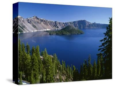 Oregon. Crater Lake NP, Wizard Island and Crater Lake with a grove of mountain hemlock-John Barger-Stretched Canvas Print