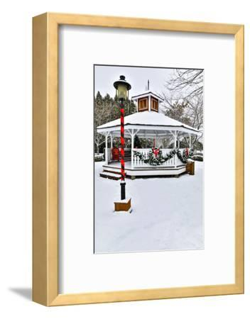 Christmas time and snow covering park in town of Snoqualmie, Washington State-Darrell Gulin-Framed Photographic Print
