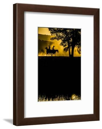California, Parkfield, V6 Ranch silhouette of two riders faced opposite directions on horseback.-Ellen Clark-Framed Photographic Print