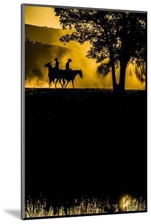 California, Parkfield, V6 Ranch silhouette of two riders faced opposite directions on horseback.-Ellen Clark-Mounted Photographic Print