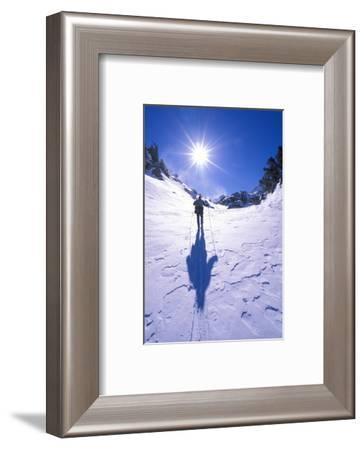 Backcountry skier crossing wind blown snow near Treasure Lakes, John Muir Wilderness, California-Russ Bishop-Framed Photographic Print