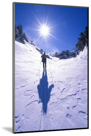 Backcountry skier crossing wind blown snow near Treasure Lakes, John Muir Wilderness, California-Russ Bishop-Mounted Photographic Print