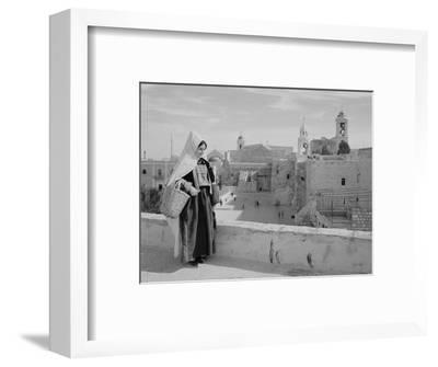 Woman on Roof Facing Church of the Nativity Photograph - Bethlehem, Palestine-Lantern Press-Framed Art Print