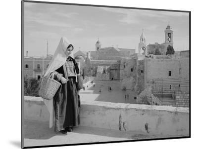 Woman on Roof Facing Church of the Nativity Photograph - Bethlehem, Palestine-Lantern Press-Mounted Art Print