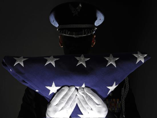 U.S. Airman Stands at Attention After Completing the Flag Dressing Sequence-Stocktrek Images-Photographic Print