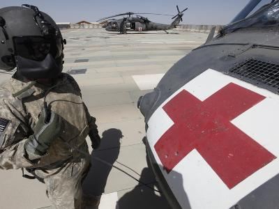 U.S. Army Crew Chief Inspects the Exterior of a UH-60 Black Hawk-Stocktrek Images-Photographic Print