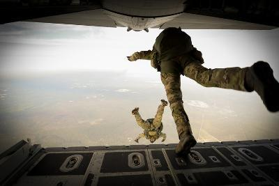 U.S. Army Green Berets Jump Out of a C-130H3 Hercules over Florida-Stocktrek Images-Photographic Print