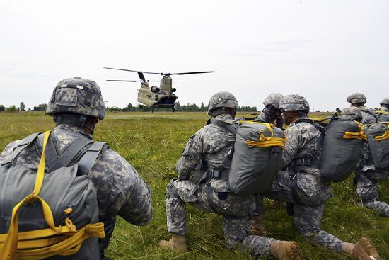 U.S. Army Paratroopers Prepare to Board a Ch-47 Chinook-Stocktrek Images-Photographic Print