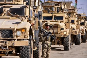 U.S. Army Soldier Stands Local Security Near Armored Convoy Vehicles