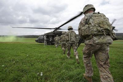 U.S. Army Soldiers Board a Uh-60 Black Hawk Helicopter--Photographic Print