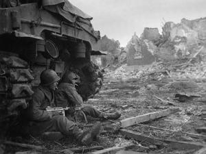U.S. Infantrymen Sheltering Behind a M-4 Sherman Tank During Heavy German Shelling