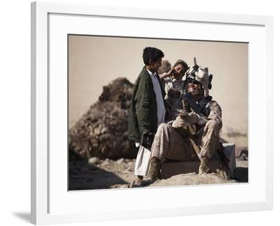 U.S. Marine Practices Pashto with Afghan Boys in Afghanistan-Stocktrek Images-Framed Photographic Print