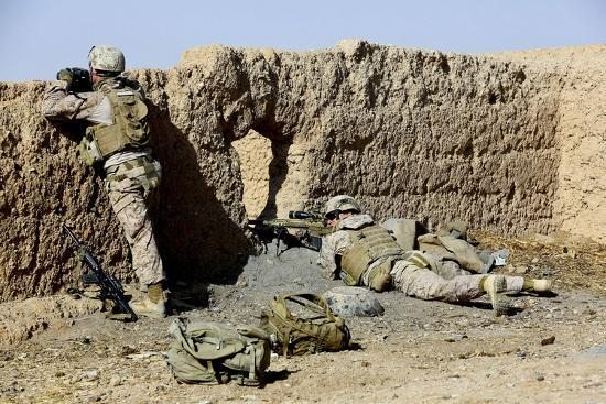 U.S. Marines Take Cover During a Patrol in Afghanistan--Photographic Print