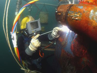 U.S. Navy Diver Welds a Repair Patch On the Submerged Bow of the USS Ogden-Stocktrek Images-Photographic Print