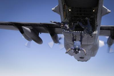U.S. Navy Parachute Team, the Leap Frogs, Jump from a C-130 Hercules-Stocktrek Images-Photographic Print