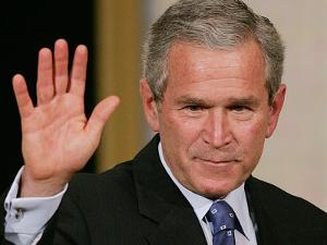 U.S. President George W. Bush Waves at the Audience