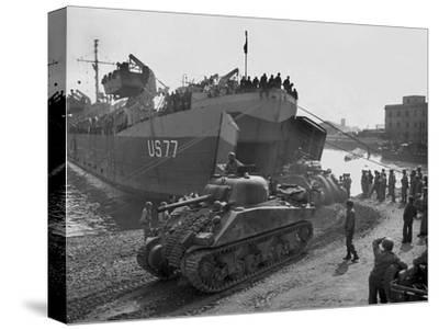 U.S. Sherman Tanks Leave a Landing Ship in Anzio Harbor, May 1944
