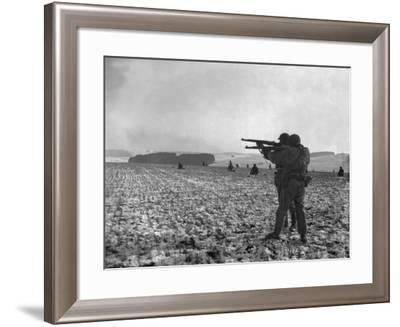 U.S. Soldiers Fire at Germans Positions to Relieve Besieged Airborne Troops in Bastogne--Framed Photo