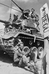 U.S. Soldiers Guard a Roadblock on the Naktong River Front in the Taegu Area with an M-24 Tank