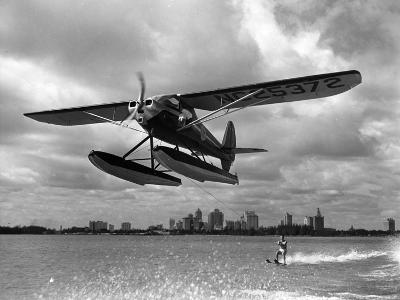 U.S. Water Ski Champion Bruce Parker Being Towed by a Seaplane across Biscayne Bay, 1946--Photographic Print