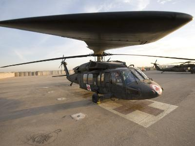 UH-60 Blackhawk Medivac Helicopter Sits on the Flight Deck at Camp Warhorse-Stocktrek Images-Photographic Print
