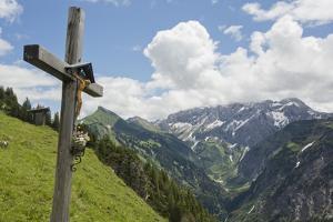 A Crucifix, or Materl, on a Hillside in an Austrian Alp Valley by Ulla Lohmann